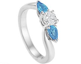 12730-palladium-diamond-and-swiss-blue-topaz-wave-shape-engagement-ring_1.jpg