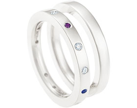 12834-Fairtrade-18ct-white-gold-eternity-ring-with-eight-diamonds-ruby-garnet-and-two-blue-sapphire_1.jpg