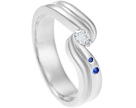 13010-diamond-and-sapphire-twisting-engagement-ring_1.jpg
