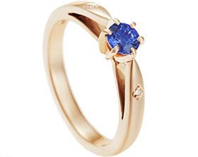 13034-9ct-rose-gold-engagement-ring-set-with-a-blue-sapphire-and-two-small-diamonds_1.jpg