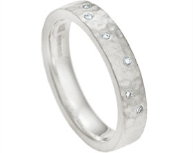 13038-diamond-eternity-ring-with-a-satinised-hammer-finish_1.jpg