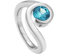 13074-Twist-inspired-eternity-ring-with-aquamarine_1.jpg