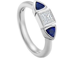 13088-palladium-princess-cut-diamond-engagement-ring-with-trilliant-cut-sapphires_1.jpg