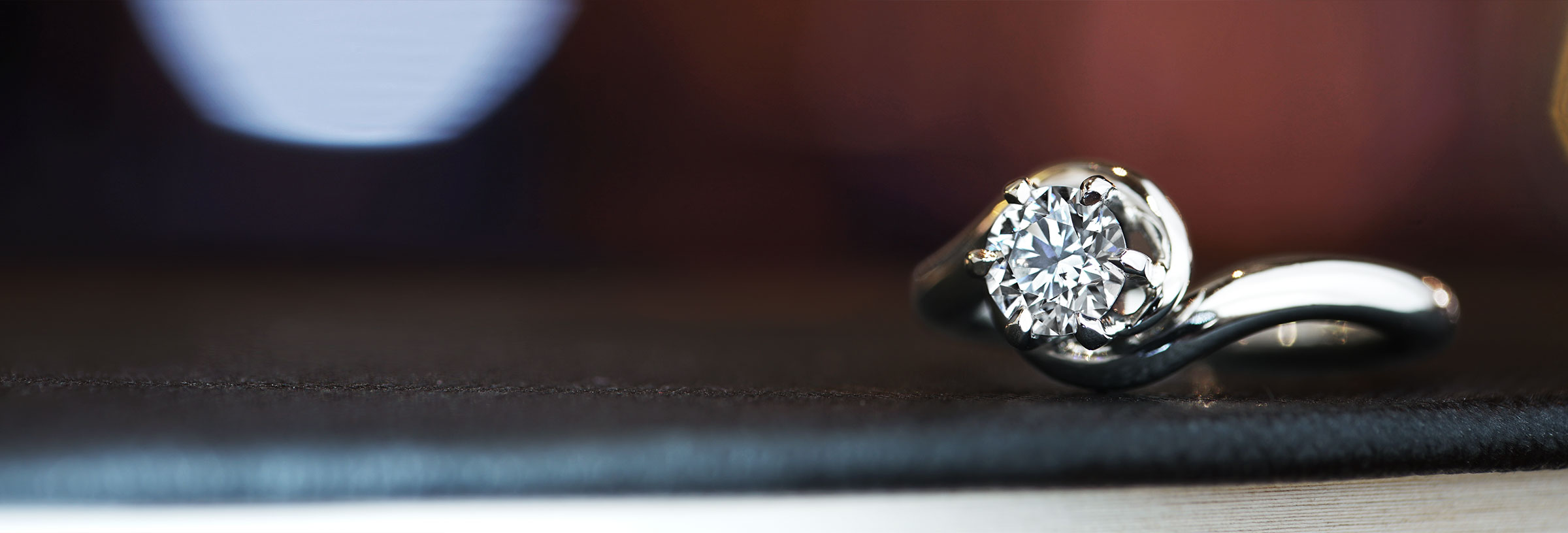 Palladium and Diamond twisting engagement ring
