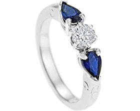 13557-platinum-diamond-and-pear-cut-sapphires-engagement-ring_1.jpg