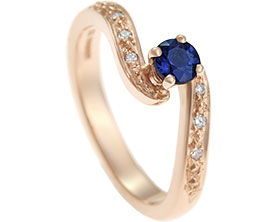 13689-9ct-rose-gold-sapphire-and-diamond-twist-style-engagement-ring_1.jpg