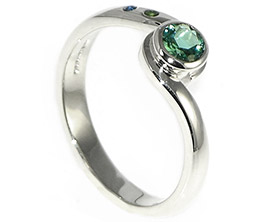 twist-style-engagement-ring-with-a-central-crisp-green-tourmaline-8437_1.jpg