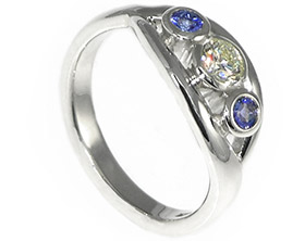 claires-diamond-and-tanzanite-trilogy-engagement-ring-8535_1.jpg
