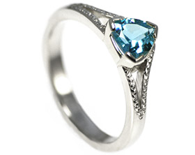 freyas-stunning-trilliant-cut-blue-topaz-engagement-ring-9899_1.jpg