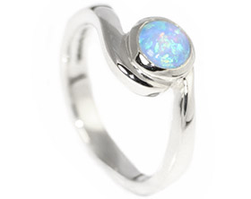 white-gold-engagement-ring-with-a-central-5mm-cabochon-cut-opal-10428_1.jpg