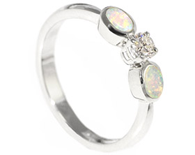 striking-opal-and-diamond-trilogy-engagement-ring-10513_1.jpg