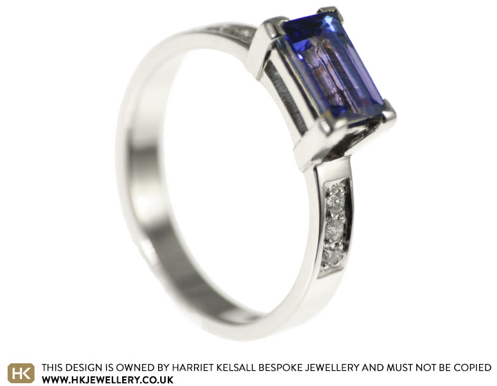 Tanzanite and pave set diamond white gold engagement ring