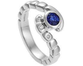13695-palladium-sapphire-and-diamond-twist-style-engagement-ring_1.jpg