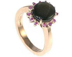 cluster-engagement-ring-with-a-star-sapphire-and-pink-sapphires-8800_1.jpg