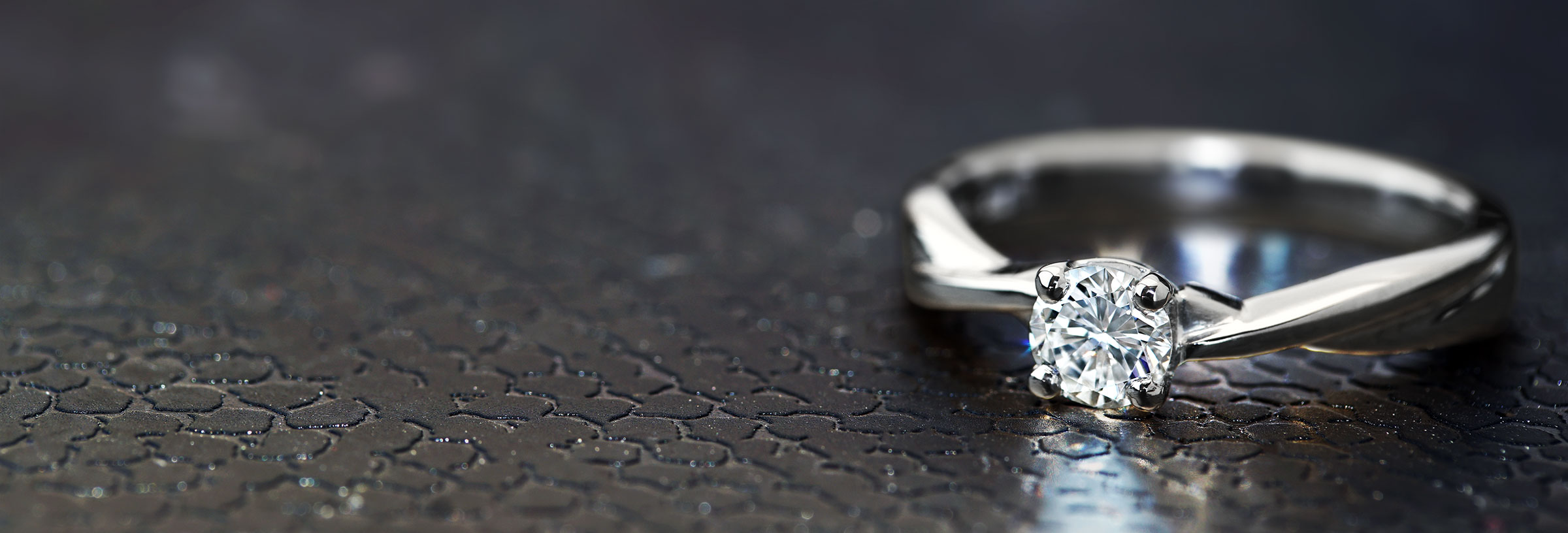 Mobius twist inspired 18 carat white gold and 0.35ct diamond engagement ring
