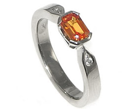 bespoke-18ct-white-gold-engagement-ring-with-a-6x4mm-069ct-emerald-cut-orange-sapphire-and-a-pair-of-15mm-brilliant-cut-h-si-diamonds-4565_1.jpg