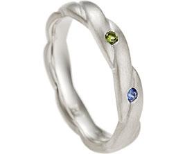 16489-twist-peridot-and-sapphire-eternity-ring_1.jpg