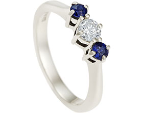 16507-Fairtrade-9-carat-white-gold-sapphire-and-diamond-three-stone-engagement-ring_1.jpg