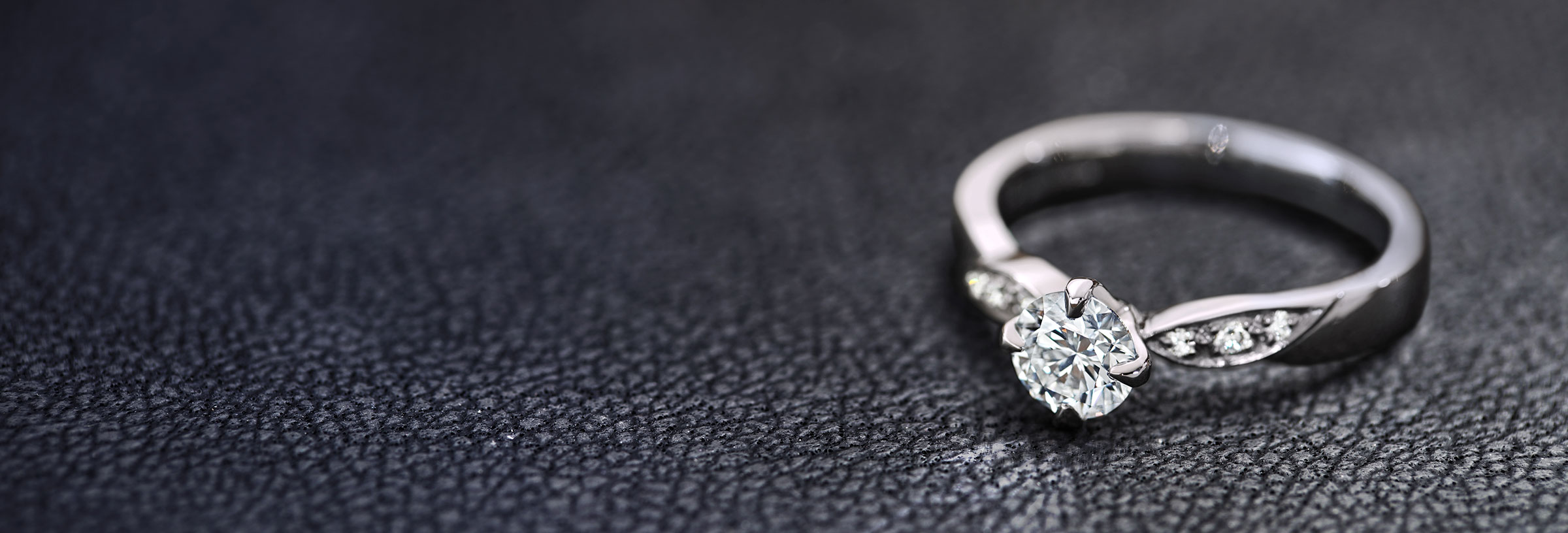 platinum and diamond engagement ring with assymetric pave set diamonds