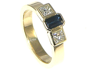 bespoke-9ct-yellow-gold-engagement-ring-with-035ct-emrald-cut-dark-blue-sapphire-4251_1.jpg