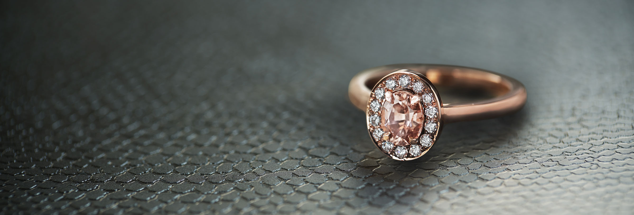 diamond-halo-peach-tourmaline-engagement-ring-in-rose-gold