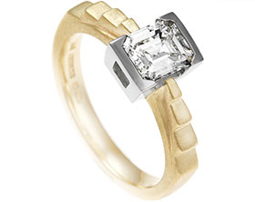 16684-palladium-and-9-carat-yellow-gold-engagment-ring-with-emeral-cut-diamond-and-set-detailing_1.jpg