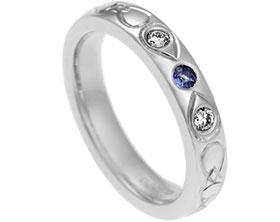 16698-flush-set-trilogy-style-ring-with-diamonds-and-sapphire-with-celtic-engraving_1.jpg