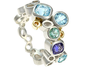 16723-fairtrade-white-gold-bubble-inspired-eternity-ring-with-aquamarine-sapphire-and-tourmaline_1.jpg