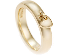 16801-9-carat-yellow-gold-dress-ring-with-heart-charm_1.jpg