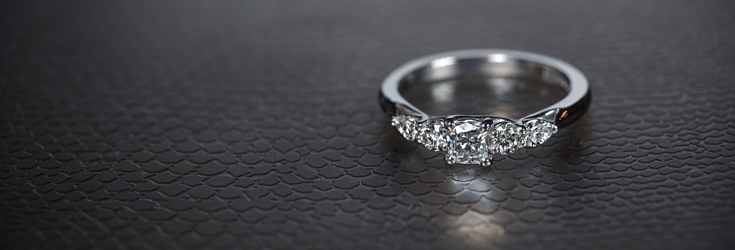 five-stone-engagement-ring-with-weaving-claw-design