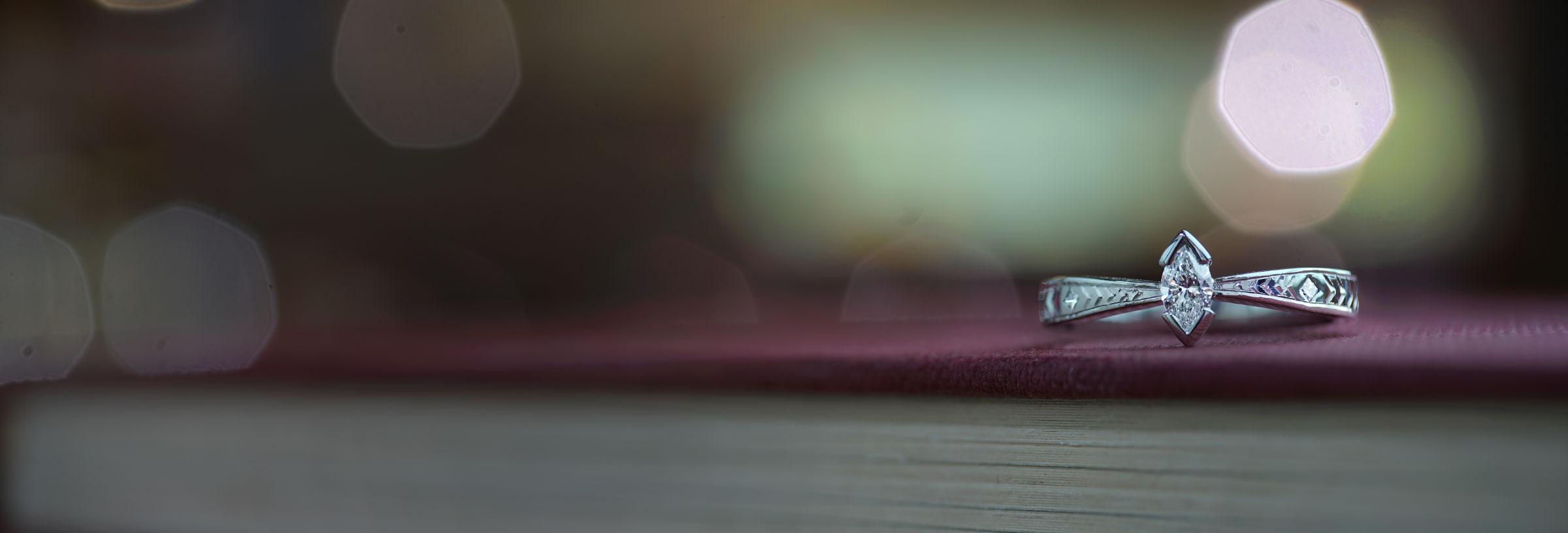 palladium-ring-with-marquise-diamond-and-chevron-engraving