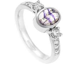 16857-platinum-three-stone-ring-with-central-cabochon-blue-john_1.jpg
