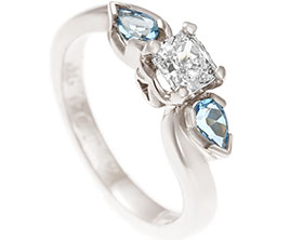 16882-white-gold-twist-style-trilogy-with-diamond-and-aquamarines_1.jpg