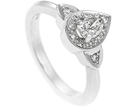 16938-pear-cut-diamond-ring-with-halo-and-side-detail_1.jpg