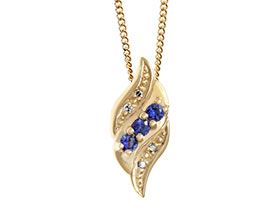 16764-yellow-gold-swirl-pendant-with-customers-diamond-and-sapphires_1.jpg