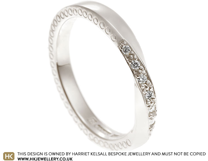 17227-white-gold-diamond-set-mobius-twist-band-with-side-engraving_2.jpg