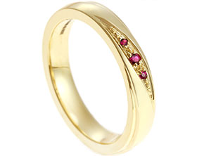 17486-fairtrade-yellow-gold-eternity-ring-with-grain-set-rubies_1.jpg
