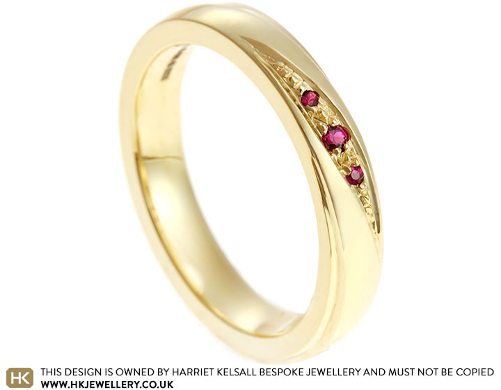 17486-fairtrade-yellow-gold-eternity-ring-with-grain-set-rubies_2.jpg