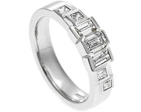 17594-emerald-and-baguette-cut-diamond-platinum-dress-ring_1.jpg