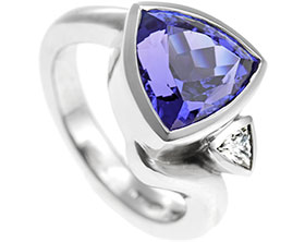 17725-trilliant-cut-tanzanite-with-diamond-and-twist-detailing_1.jpg