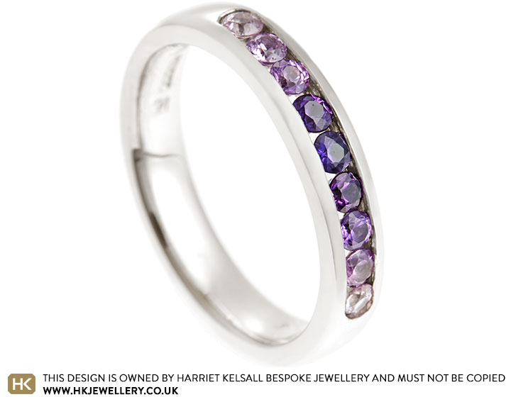 15967-Fairtrade-9-carat-white-gold-eternity-ring-with-channel-set-purple-sapphires_2.jpg