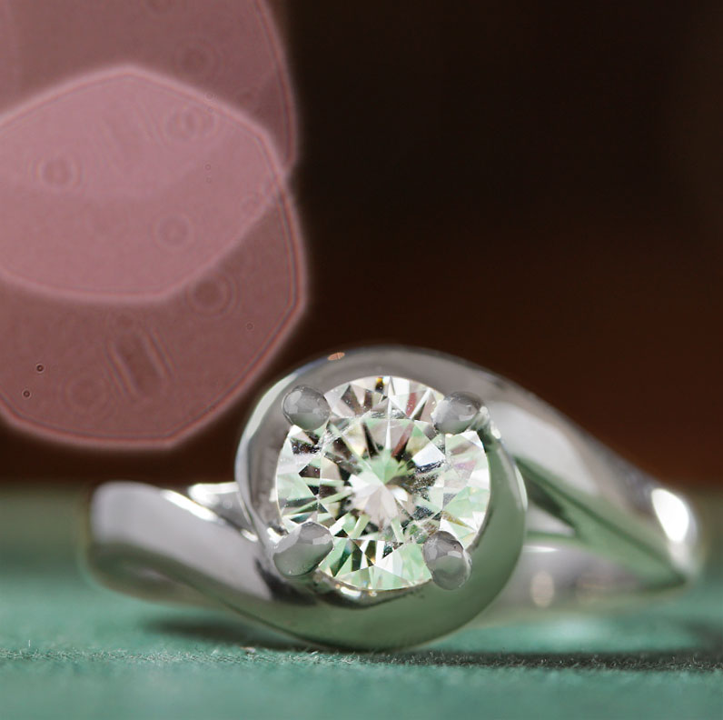 17616-platinum-solitaire-engagement-ring-in-twist-design_9.jpg