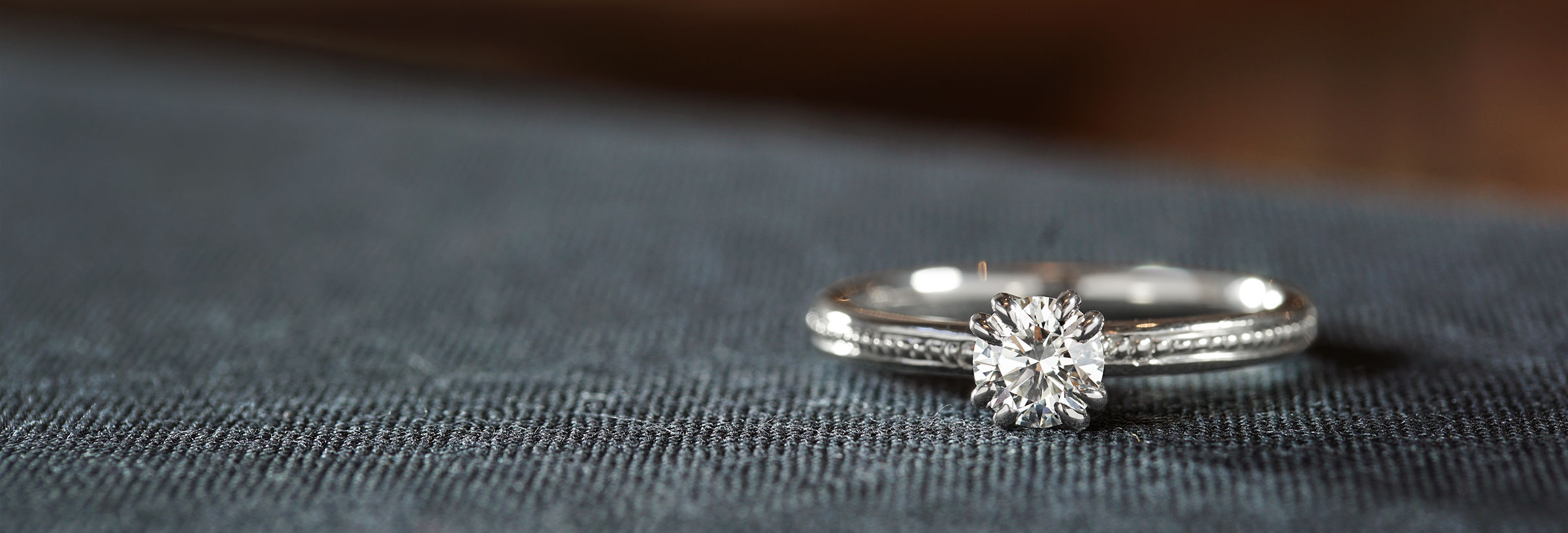palladium-double-claw-engagement-ring-with-beaded-band