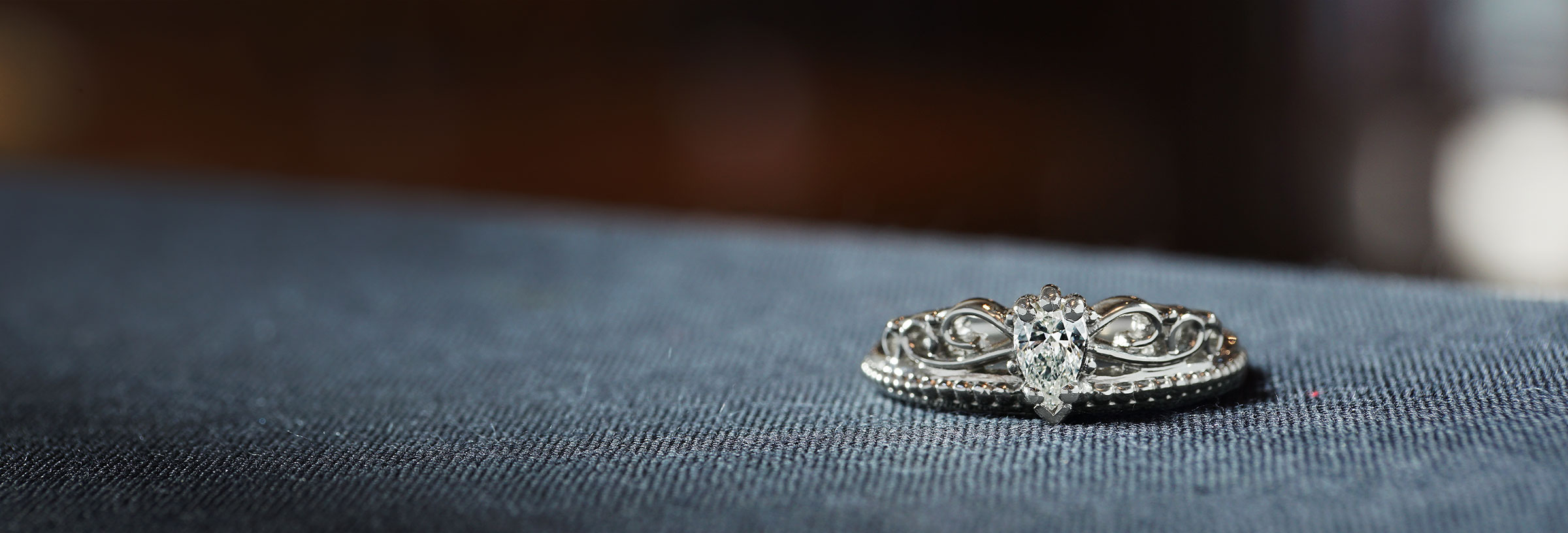 palladium-tiara-inspired-engagement-ring-with-pear-cut-diamond