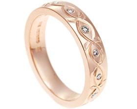 17760-Fairtrade-9-carat-celtic-floral-inspired-diamond-eternity-ring_1.jpg