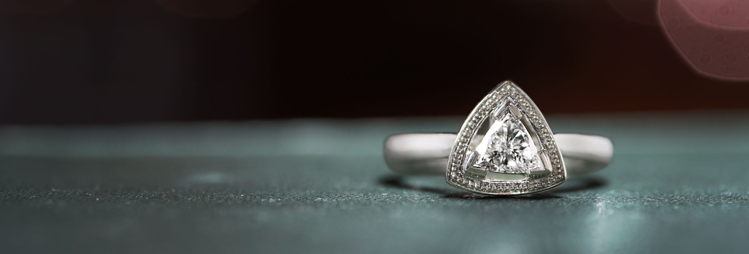 platinum-trilliant-cut-engagement-ring-with-beading-detail