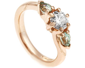 17790-Fairtrade-rose-gold-engagement-ring-with-diamond-and-pear-cut-sapphires_1.jpg