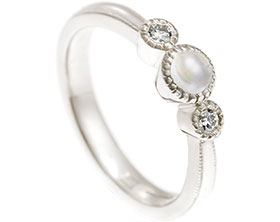 17848-9-carat-white-gold-moonstone-and-diamond-trilogy-engagement-ring_1.jpg