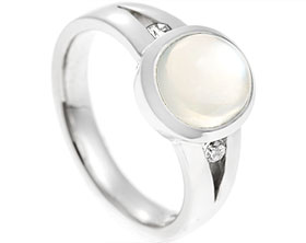 17431-palladium-cabochon-cut-moonstone-and-diamond-split-shoulder-engagement-ring_1.jpg