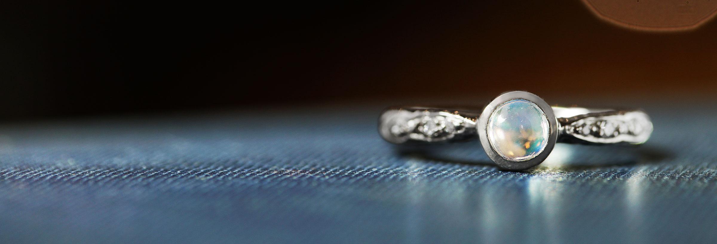 palladium-engagement-ring-with-moonstone-and-diamonds